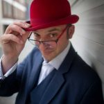 a picture of the magican Danny Jurmann aka Red Hat Magic in his trademark red bowler hat