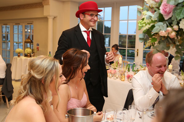 Wedding guests laughing with the Surrey wedding magician