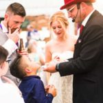 a little boy looks at the wedding magician