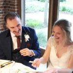 Bride and groom laughing at magic trick