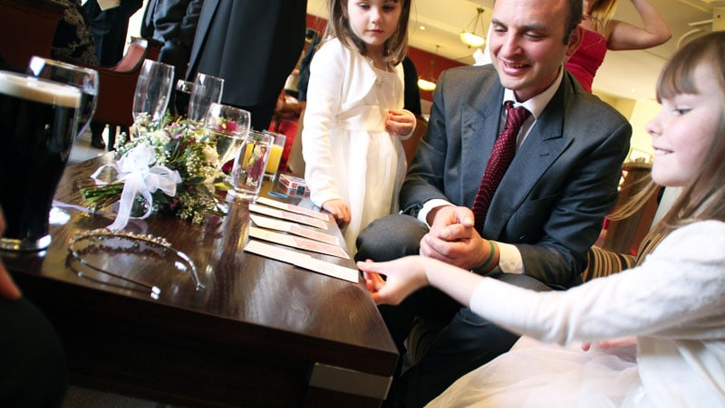 Young child smiling as she enjoys the magic at a wedding